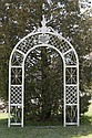 AMERICAN FOLK ART WHITE PAINTED LATTICE-WORK ARCH WITH SHIELD MOTIF.