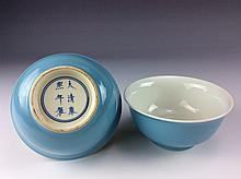 Pair of blue glazed bowls, marked