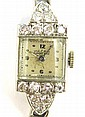 LADY'S DIAMOND AND FOURTEEN KARAT GOLD WRISTWATCH,
