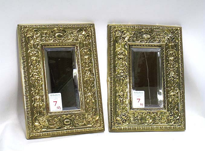 PAIR OF 19TH CENTURY REPOUSEE BEVELED MIRRORS of