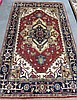 HAND KNOTTED ORIENTAL CARPET, Persian Serapi design, the hexagonal brick-red field centering  a single geometric medallion, 4'11' x 7'10