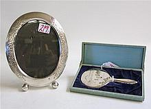 STERLING SILVER PICTURE FRAME AND HAND MIRROR, the