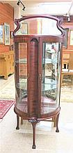 PETITE MAHOGANY AND CURVED GLASS CURIO CABINET,