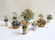 ENAMELED METAL STILL LIFE FLORAL SCULPTURES, nine