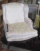 LOUIS XV STYLE WINGBACK ARMCHAIR, having a carved