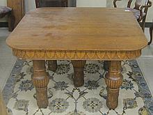 LATE VICTORIAN SQUARE OAK DINING TABLE WITH THREE