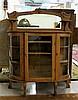 LOW OAK AND CURVED GLASS CHINA CABINET, American,