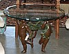 FIGURAL GLASS-TOP TABLE, featuring a group of
