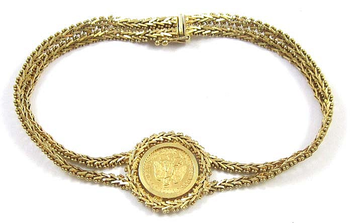 GOLD COIN AND EIGHTEEN KARAT GOLD CHAIN BRACELET,
