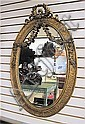 AN AMERICAN OVAL WALL MIRROR in the Victorian