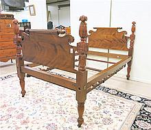 EMPIRE MAHOGANY BED WITH RAILS, American, second quarter of the 19th century, a 3/4 size bed with four carved pineapple finials.  Headboard dimensions:  53.5