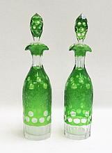 PAIR BOHEMIAN CUT CRYSTAL DECANTERS, emerald green flashed and engraved with fruiting grape vine motif. Heights 13.5 inches.