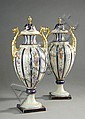 PAIR GERMAN PORCELAIN COVERED URNS in the French