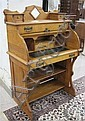 AN OAK CYLINDER-ROLL WRITING DESK, American, late