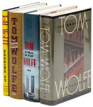 Four first editions by Tom Wolfe, signed