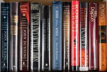 Shelf of works by John Dunning, Louis de Bernières and Robert Harris