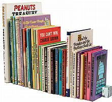 Lot of thirty Peanuts books - including one signed by Charles Schulz
