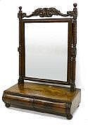 An early 19th century mahogany toilet mirror in
