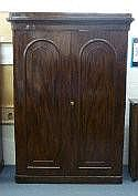 A Victorian mahogany double wardrobe enclosed by a