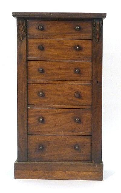 A Victorian walnut Wellington chest of six