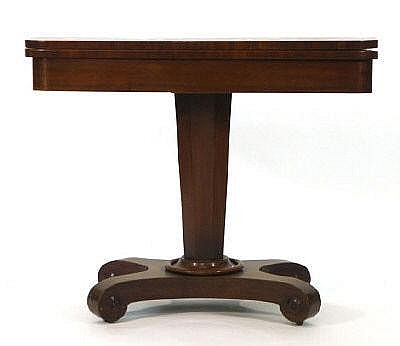 An early 19th century mahogany card table, the