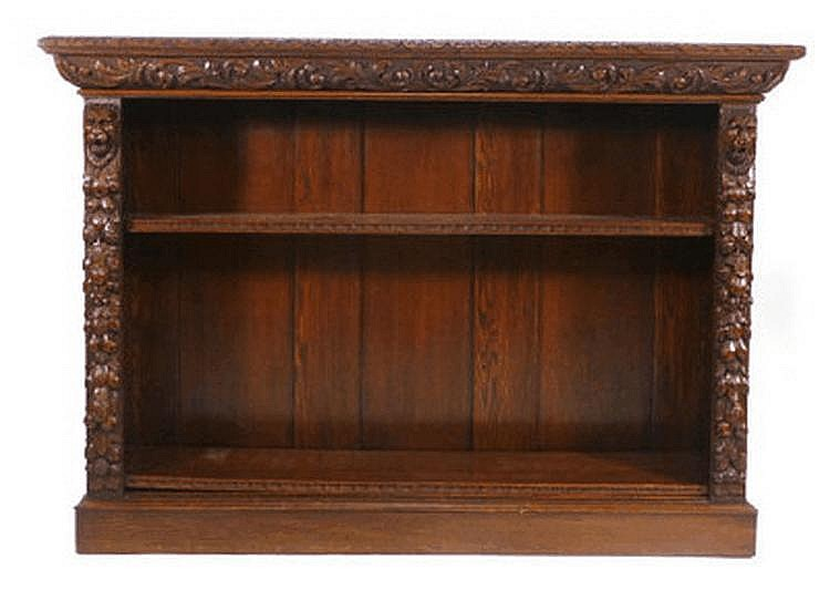A late Victorian carved oak dwarf bookcase with