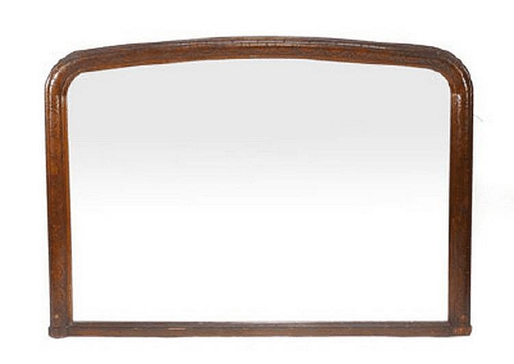 A 19th century continental oak framed over mantle