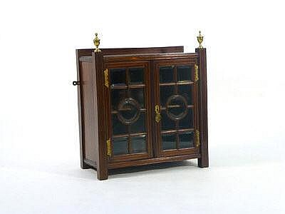 An Edwardian mahogany and strung hanging cabinet,