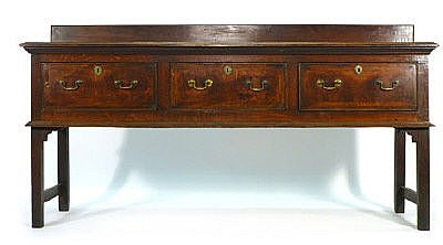 An 18th century oak low dresser base with three