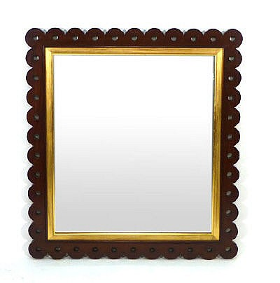 A rectangular wall mirror in a pierced mahogany