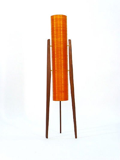 A 1970s rocket style lamp on teak three legged