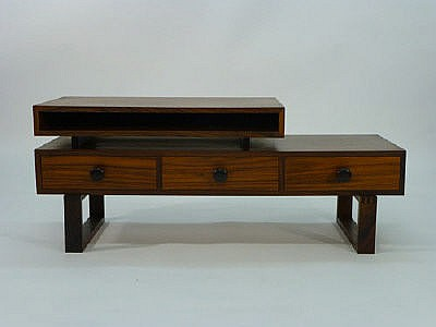 A rosewood coffee table, having smaller galleried