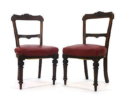 A pair of Edwardian stained beech dining chairs