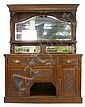 An Edwardian walnut mirror backed sideboard on a