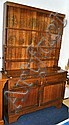 Oak dresser with open rack and lower cupboards
