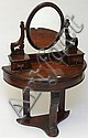A Victorian mahogany 'Duchess' dressing table