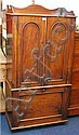 A Victorian mahogany cupboard with 3/4 gallery,