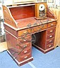 An Edwardian mahogany roll top pedestal desk 102cm