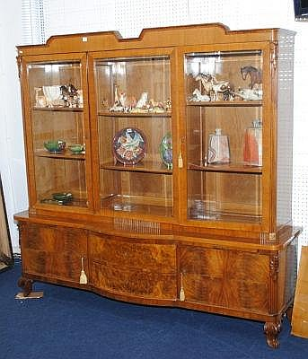 Walnut triple door display cabinet in the Art Deco