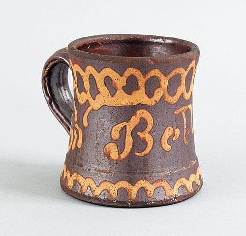 Virginia redware mug, ca. 1860, impressed Solomon