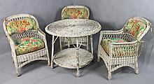 EARLY TWENTIETH CENTURY WICKER CIRCULAR TABLE AND THREE CHAIRS