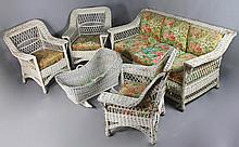BAR HARBOR TURN OF THE CENTURY WHITE PAINTED WICKER SOFA AND A PAIR OF CHAIRS, ANOTHER SIMILAR CHAIR, TOGETHER WITH A WICKER CRADLE