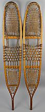 PAIR OF VINTAGE HANDMADE BENT WOOD AND LACED RAWHIDE SNOWSHOES