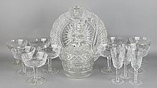 BRILLIANT CUT EWER AND STOPPER AND TWELVE WATERFORD GLASSES