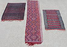 THREE ASSORTED FLAT WEAVE TRIBAL RUGS, INCLUDING A RUNNER