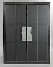 CONTEMPORARY EBONIZED AND LEATHER INSET CABINET WITH MIRRORED HANDLES