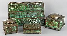 FOUR TIFFANY STUDIOS BRONZE AND GLASS DESK ACCESSORIES