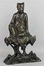 CHINESE BRONZE MODEL OF SEATED WOMAN ON ROCKERY, MING DYNASTY