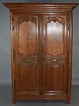 19TH C. FRENCH PROVINCIAL CARVED WALNUT ARMOIRE OF LARGE PROPORTIONS