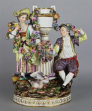MEISSEN STYLE GROUP OF A COUPLE WITH AN URN